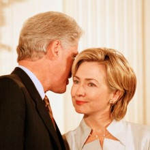 WASHINGTON - AUGUST 11:  (NO U.S. TABLOID SALES)  President Bill Clinton whispers in wife Hillary's ear during the Medal of Freedom event where former President Gerald R. Ford was honored at the White House August 11, 1999 in Washington DC.  (Photo by David Hume Kennerly/Getty Images)